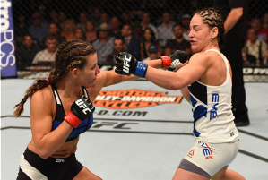 Miesha Tate connects on a punch versus Jessica Eye at UFC on FOX (Photo credit Getty Images via UFC.com)