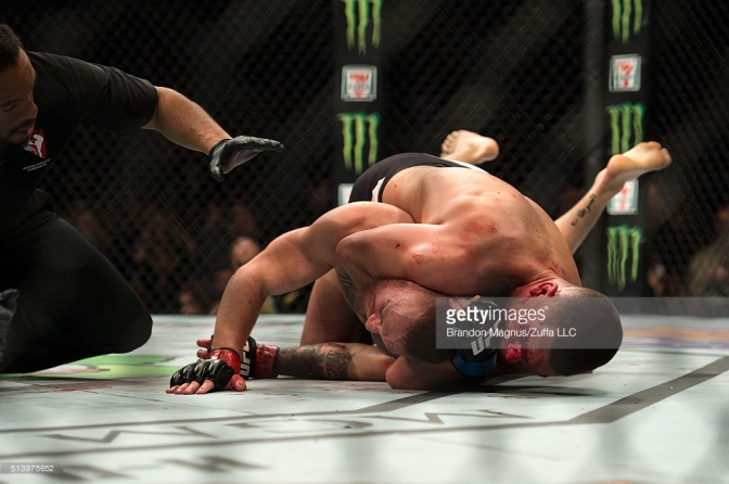 Nate Diaz sinks in the rear-naked choke against Conor McGregor (Credit Getty Images)